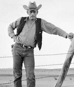 James Dean Standing at Fence in Cowboy Gear on set of 'Giant' by
