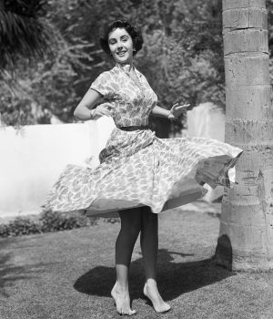 Elizabeth Taylor Spins on Lawn 1948 by