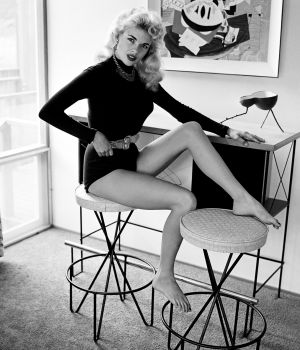 Jayne Mansfield Straddles Bar Stool by